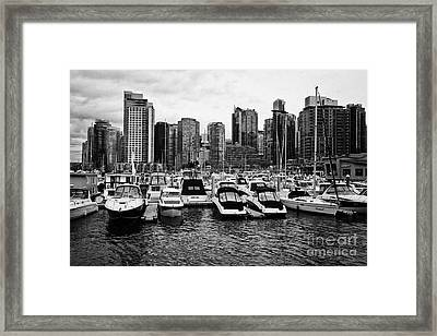 coal harbour marina and high rise apartment condo blocks in the west end Vancouver BC Canada Framed Print by Joe Fox