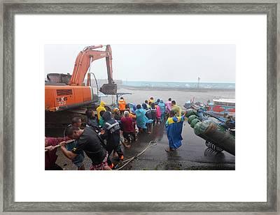 Coastal Defences During Typhoon Usagi Framed Print by Jim Edds
