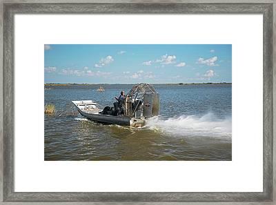 Coastal Wetlands Airboat Framed Print by Jim West