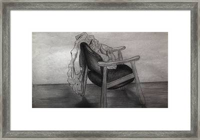 Coat In The Empty Chair Framed Print