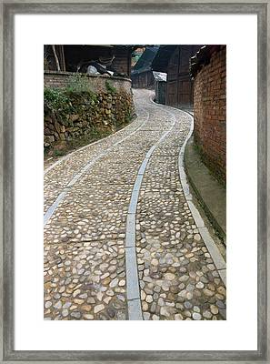 Cobbled Street In The Miao Village Framed Print by Keren Su
