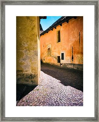 Framed Print featuring the photograph Cobbled Street by Silvia Ganora