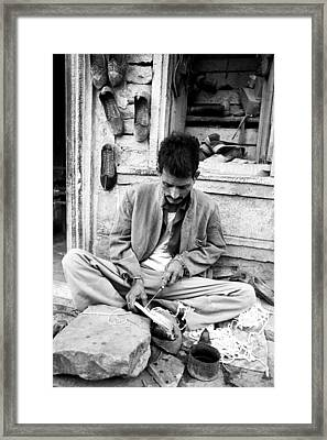 Cobbler Making Shoes Framed Print by Jagdish Agarwal