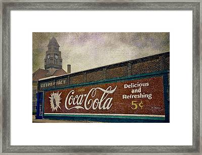 Coca-cola And A Courthouse Framed Print by Joan Carroll