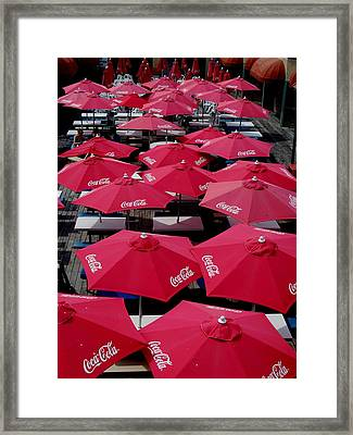 Coca Cola Red Umbrella's Framed Print by Rick Todaro