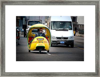 Coco Taxi Framed Print