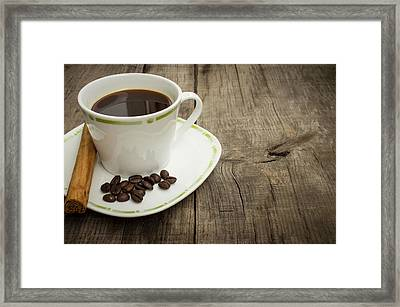 Coffee Cup With Beans And Cinnamon Stick Framed Print by Aged Pixel