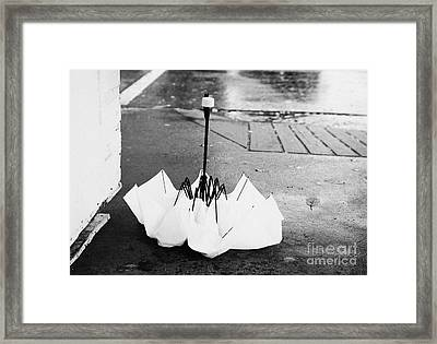 collapsed broken yellow umbrella on a wet rainy day in downtown Vancouver BC Canada Framed Print