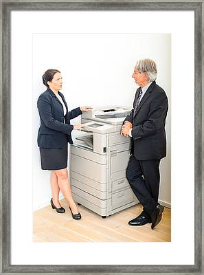 Colleagues Talking At  Copying Machine In The Office Framed Print by Frank Gaertner