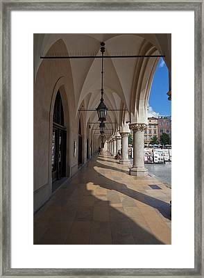 Colonade Along The Side Of Sukiennice Framed Print by Panoramic Images