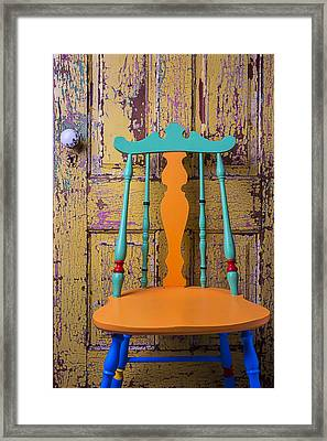 Colorful Chair And Old Door Framed Print by Garry Gay
