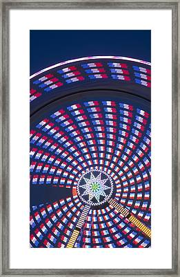 Colorful Spinning Ferris Wheel Close-up Framed Print by John Franco