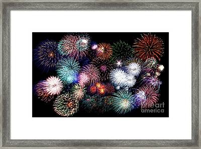 Colorful Fireworks Of Various Colors In Night Sky Framed Print by Stephan Pietzko