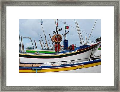 colorful fishing boat with Portuguese flag  Framed Print
