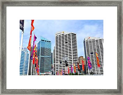 Colorful Flags Lead To City By Kaye Menner Framed Print by Kaye Menner