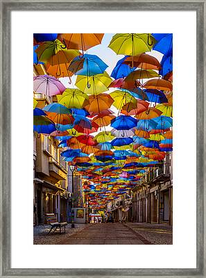 Colorful Floating Umbrellas Framed Print by Marco Oliveira