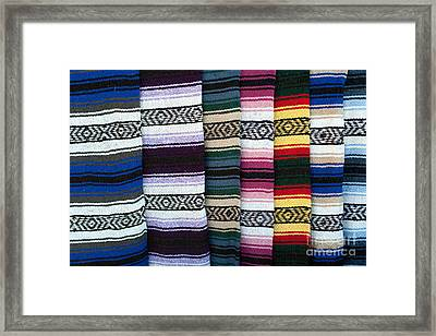 Framed Print featuring the photograph Colorful Indian Rug Display by Gunter Nezhoda
