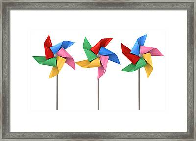 Colorful Pinwheels Isolated Framed Print by Allan Swart