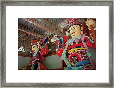 Colorful Statues At The Buddhist Framed Print by Michael Runkel