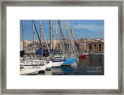 Colors In The Port Framed Print by John Rizzuto