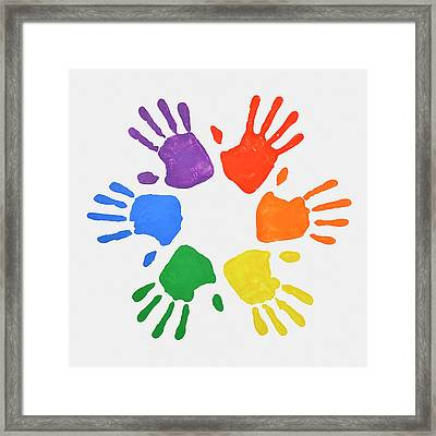 Coloured Handprints Facing Outwards Framed Print by David Malan