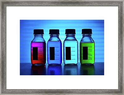 Coloured Liquids In Plastic Bottles Framed Print