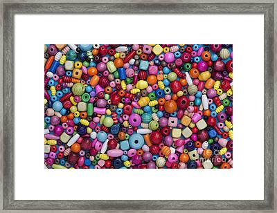 Colourful Wooden Beads Framed Print by Tim Gainey
