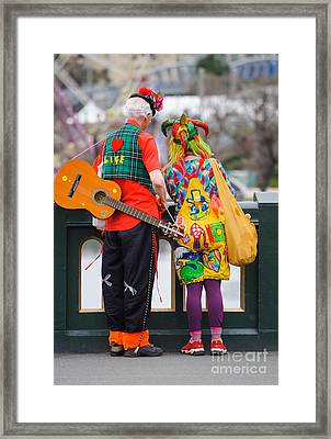 Colourfully Dressed Buskers Pause On The Way Home Framed Print