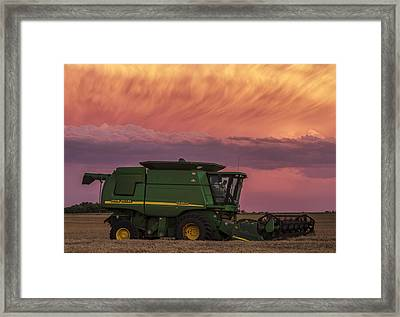 Framed Print featuring the photograph Combine At Sunset by Rob Graham