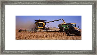 Combine Harvesting Soybeans In A Field Framed Print