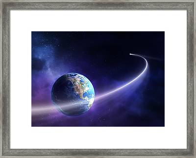 Comet Moving Past Planet Earth Framed Print