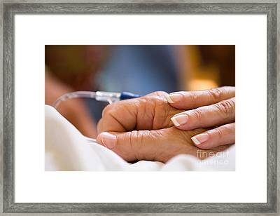 Comforting Hand Framed Print