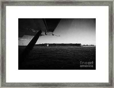Coming In To Land On The Water In A Seaplane Next To Fort Jefferson Garden Key Dry Tortugas Florida  Framed Print by Joe Fox