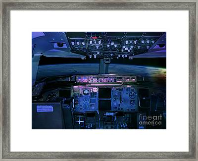 Framed Print featuring the photograph Commercial Airplane Cockpit By Night by Gunter Nezhoda