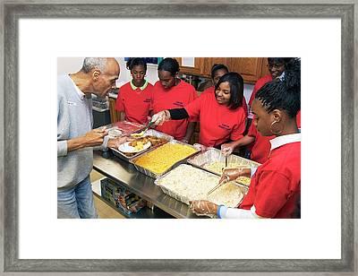 Community Volunteers Serve Food Framed Print