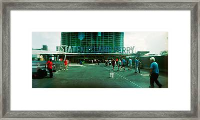 Commuters In Front Of A Ferry Terminal Framed Print by Panoramic Images