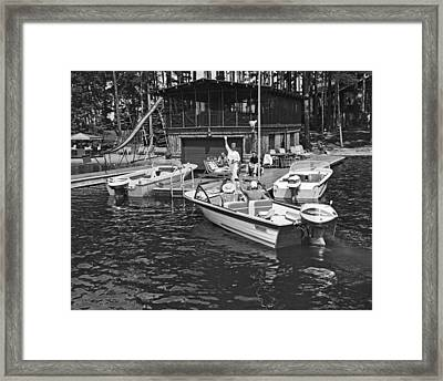 Company Arrives At The Cabin By Boat Framed Print