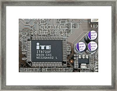 Computer Microchip And Capacitors Framed Print by Martyn F. Chillmaid