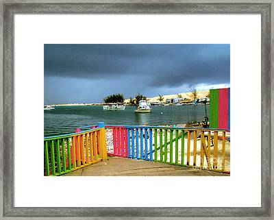 Conch Boats Arriving Framed Print by Luther Fine Art