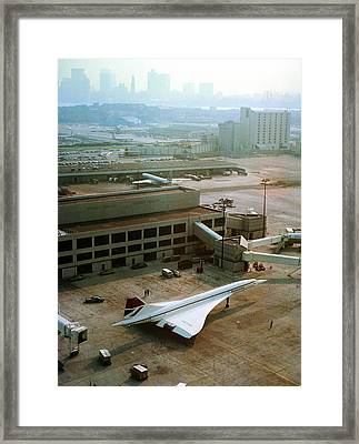 Concorde At An Airport Framed Print