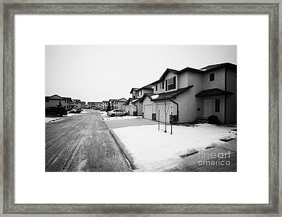 condos with snow cleared from streets and driveways Saskatoon Saskatchewan Canada Framed Print by Joe Fox