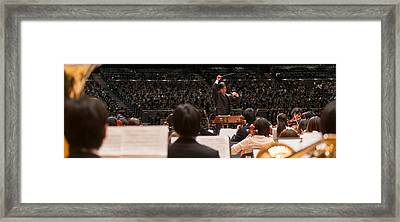 Conductor Leading Orchestra Framed Print by Panoramic Images