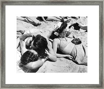 Coney Island - Beach Sunbathers Framed Print by MMG Archives