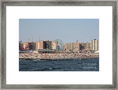 Coney Island Seen From The Pier Framed Print by John Telfer