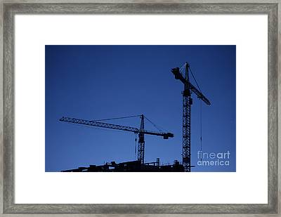 Construction Cranes At Dusk Framed Print by Antony McAulay