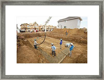 Construction Workers And Rows Of Houses Framed Print