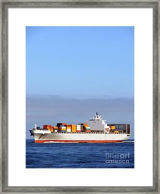 Container Ship At Sea Framed Print by Olivier Le Queinec