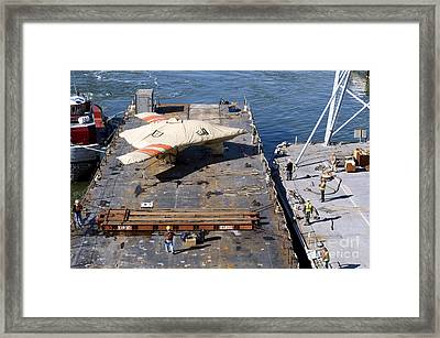 Contractors Prepare To Hoist The X-47b Framed Print by Stocktrek Images