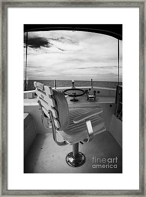 Controls On The Flybridge Deck Of A Charter Fishing Boat In The Gulf Of Mexico Framed Print by Joe Fox