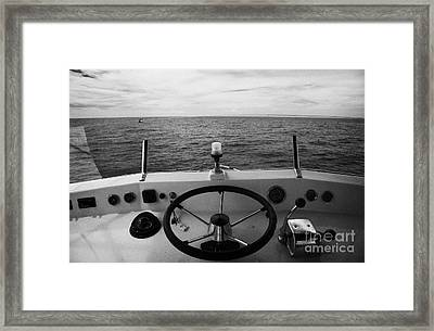 Controls On The Flybridge Deck Of A Charter Fishing Boat In The Gulf Of Mexico Out Framed Print by Joe Fox